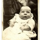 Photo of an Infant in the Arms of a Loved One - Photo #3 (1900-1920)
