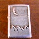 """""""Extinct"""" Marlboro Cigarette Lighter – Zippo  - Silver with Mountain Scene"""