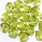 12 SWAROVSKI CRYSTAL LIGHT OLIVINE- 4MM BICONE BEADS