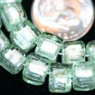 GREEN FOIL CUBE GLASS BEADS-14 INCH STRAND