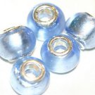 5 EUROPEAN GLASS CHARM BEADS - BLUE FOIL