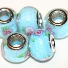 5 EUROPEAN GLASS CHARM BEADS - GREEN FLOWER