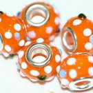 5 EUROPEAN GLASS CHARM BEADS - ORANGE SPOTTED