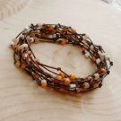 Peaches and Cream Beaded Birds Nest Leather Wrap Bracelet