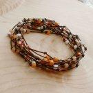 Peaches and Cream Beaded Birds Nest Leather Wrap Bracelet