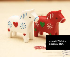 A Set of Red and White Pony