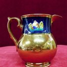 Luster ware Pitcher Copper Raised Nature Scene