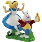 Alice In Wonderland - Alice Chassing White Rabbit Holding Clock Salt and Pepper
