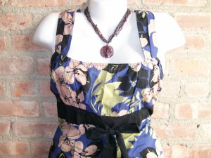 OutFitKit black empire waist bold flower print sleeveless tunic with black skirt and accessories
