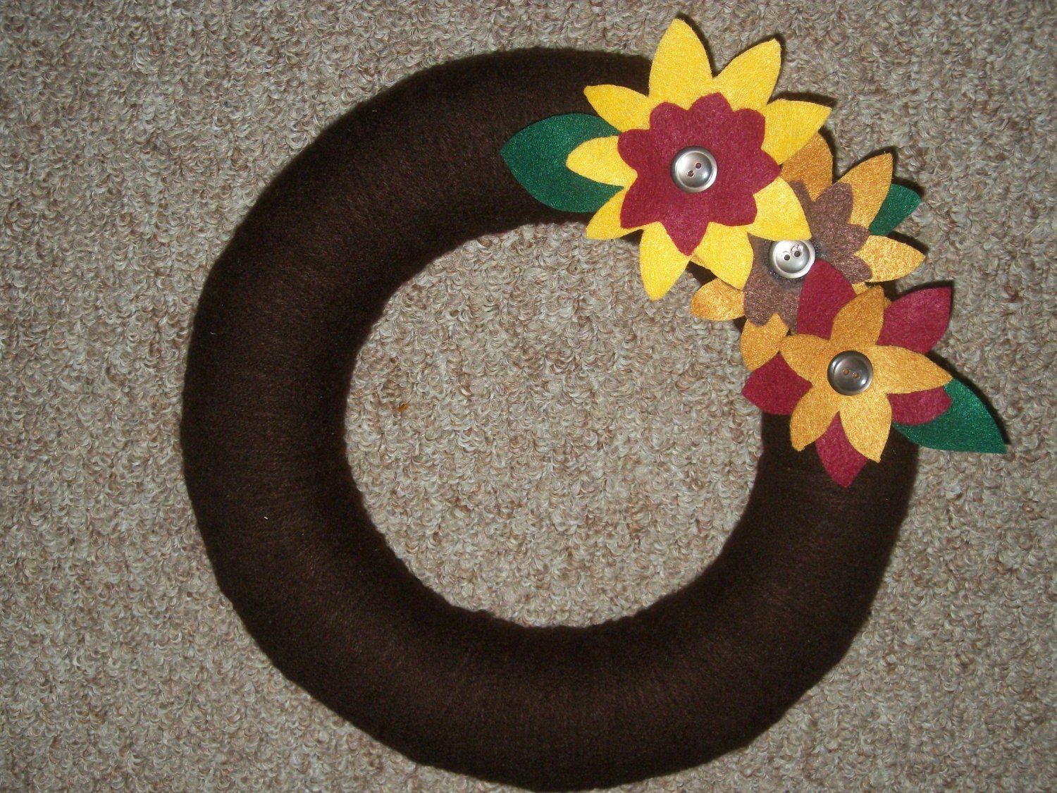 Hand made wreath with decorative flowers