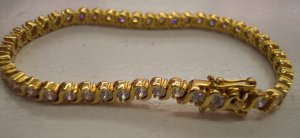 Goldtone CZ Tennis Bracelet With Safety Clasp 680-70