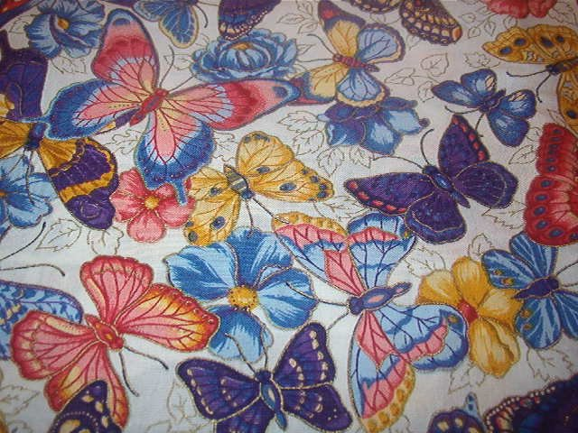 "Butterflies and Flowers Blue, Red, Yellow, Purple Cotton Fabric  23""L x 45""W"