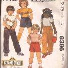 McCalls 8386 (1983) Childs T-Shirt Pants Shorts Iron-On Burt Ernie Sesame Street Pattern Size 5 CUT