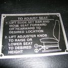 "Metal To Adjust Seat Self Adhesive Decal  Size: 3 1/4"" X 2 3/8""  UPC:71053447797"