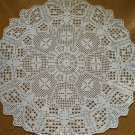 White crocheted doily with Butterflies