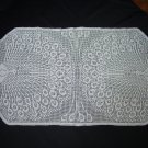 White handmade crocheted tablecloth with peacocks