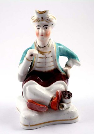 Antique Victorian Staffordshire Figure seated turk