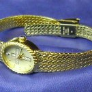 Sarah Coventry ladies watch, with cross, gold color with clear stones, new battery.