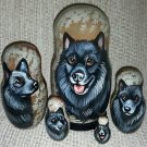 Swedish Lapphund on Five Russian Nesting Dolls. Dogs.