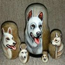 Kishu Ken on Five Russian Nesting Dolls. Dogs.