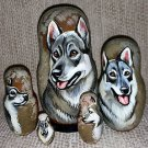 Swedish Vallhund on Five Russian Nesting Dolls. Dogs.
