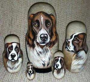 Deutscher Wachtelhund (German Spaniel) on Five Russian Nesting Dolls. Dogs.
