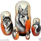 Swedish Elkhound on Five Russian Nesting Dolls. Dogs.