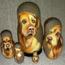 Wirehaired Vizsla on Five Russian Nesting Dolls. Dogs.
