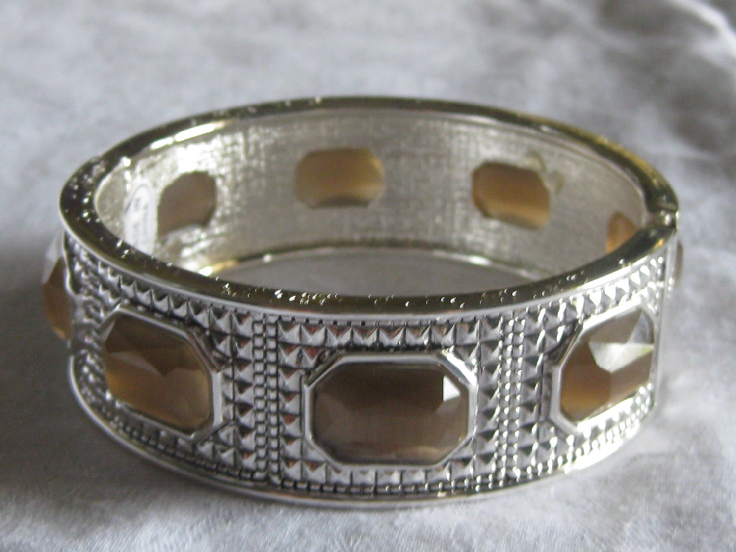 Silver with brown stones