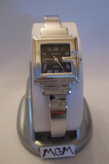 Woman watch with black square face
