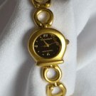 Women's Gold Tone Bracelet Watch With A Black Face
