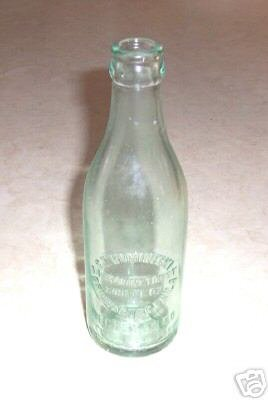 1930s BRIDESBURG PA S.T. ROMINECKI EMBOSSED BOTTLE