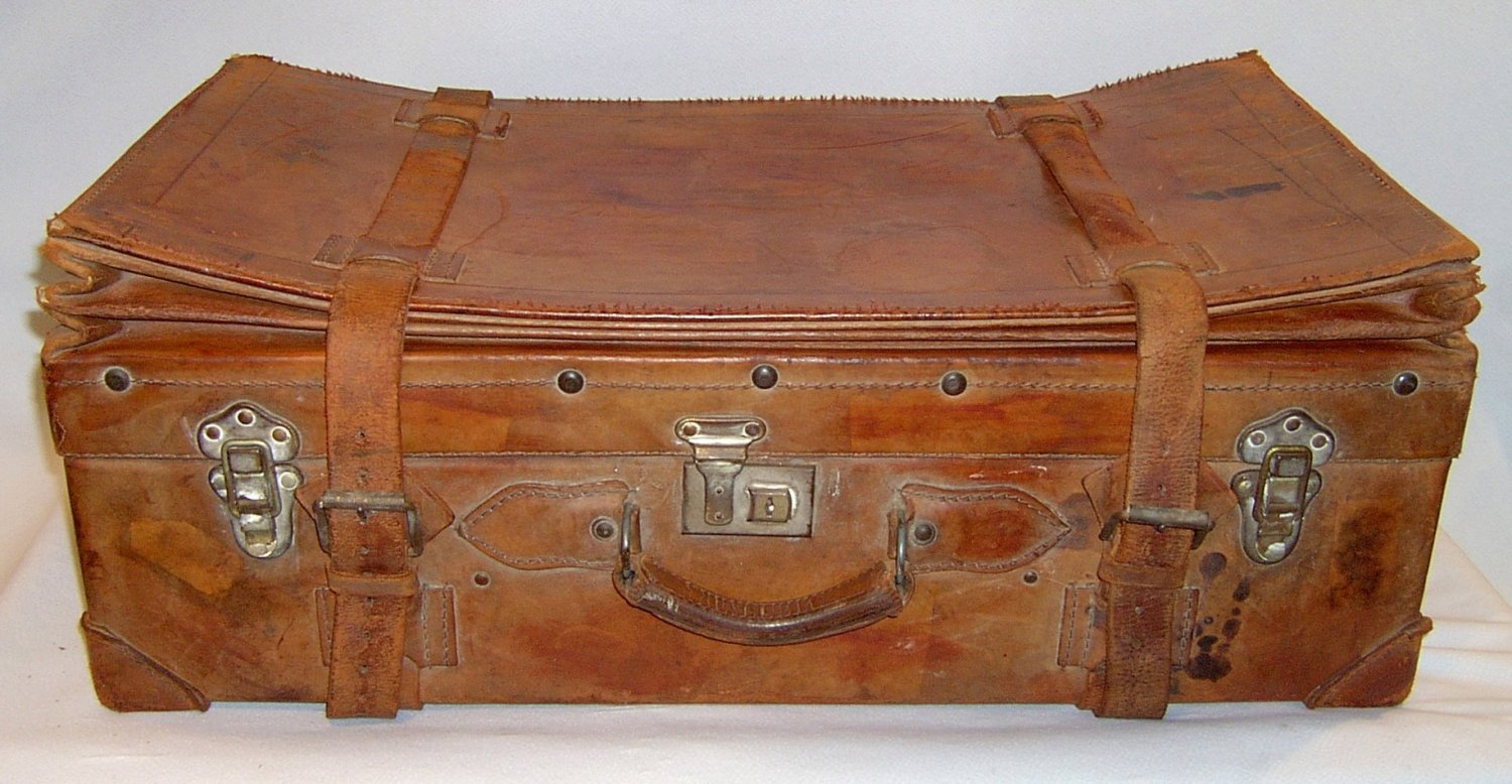 Antique leather suitcase Cuban expanding with straps, false bottom and key