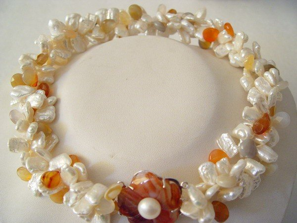 3 strands white Biwa pearl with a red agate clasp