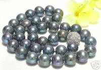 $4900 Amazing 10.5-11mm round black pearls Necklace