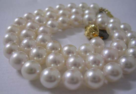 $6000 AAA 6.5-7MM WHITE SEA PEARL 14K