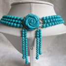 3 row turquise bead necklace with flower clasp