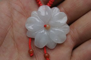 Natural jade pendant. White carved jade pendant. Lucky charms.