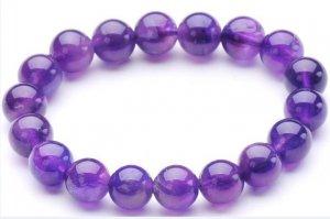 .Amethyst Bracelet (10 mm) of hand-carved; 18 beads.