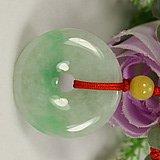 Floating emerald green peace buckle. Pendant. Good luck pendant.
