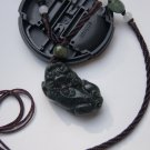 Natural dark green jade, hand-carved brave. Pendant