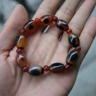 Natural red and black cloud (agate), nine drum beads.. Bracelet.