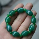Dark green (agate), hand-carved, drum-shaped beads (bracelets). The rubber band strung together.