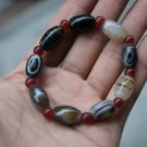 Nature black wrapping (agate) hand-carved, drum-shaped beads (bracelets).