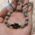 The natural oil jade. Hand-carved. Chinese auspicious knot beads. Hand-woven bracelet