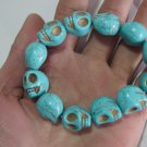 Hubei turquoise. Hand-carved skull-shaped beads bracelet, rubber band strung together.