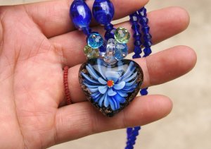 Artificial crystal blue orchid) of the (heart-shaped necklace pendant.28 x30 mm.