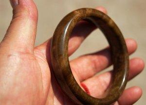 Hand-carved, natural alexandrite, dark reddish brown, bracelets, and about 60 mm internal diameter