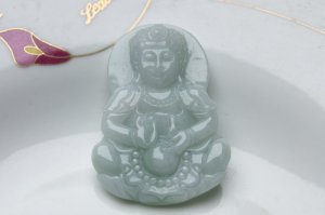 Natural white jade.Amulets, the goddess Guanyin hand-carved.Necklace Pendants
