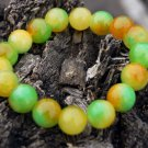 Yellow red green jade bracelet.13 mm, 17 beads. The tension of the rubber band.